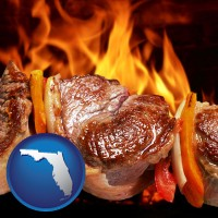 florida map icon and meat on a hot barbecue grill