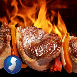 meat on a hot barbecue grill - with New Jersey icon