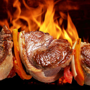 meat on a hot barbecue grill